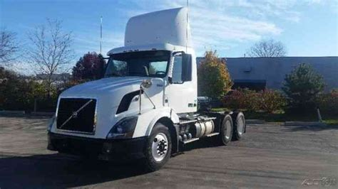 2011 volvo semi truck volvo vnl64t300 2011 daycab semi trucks
