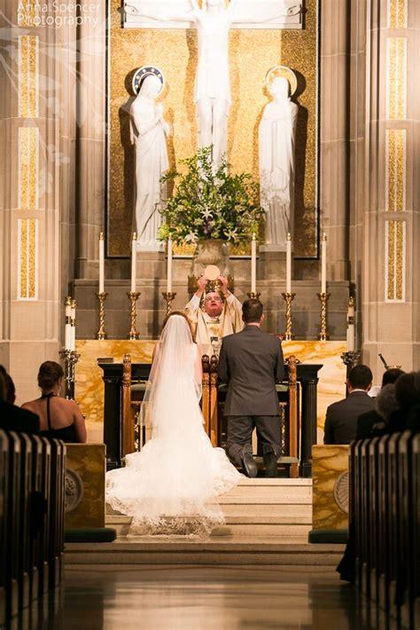 wedding ceremony and reception church and spencer photography atlanta documentary wedding photographers communion at a catholic