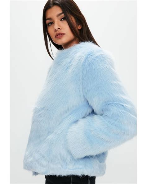 light blue faux fur coat lyst missguided light blue collarless faux fur coat in blue