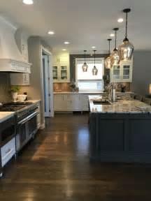 white cabinets granite island dark wood floor gray