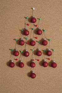 Photo of Christmas baubles on notice board Free