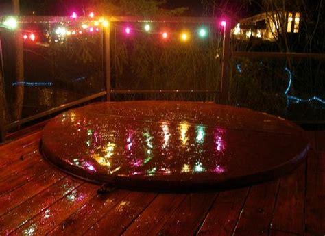 lights around tub on deck overlooking lake