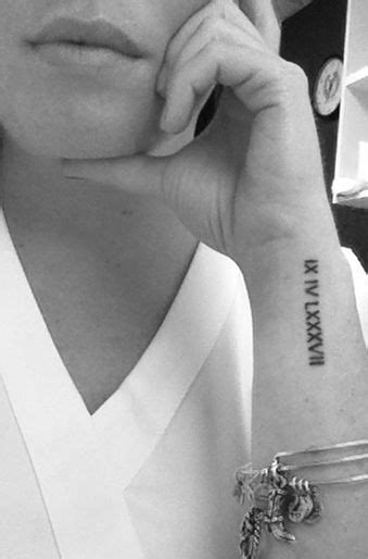 Roman Numeral Wrist Tattoo Designs, Ideas and Meaning