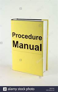 Book With Yellow Cover Thats Says Procedure Manual Stock