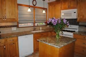 moen black kitchen faucet maple butterscotch cabinets venetian gold granite