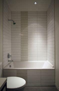 white tile stacked gray groutoption  masterbath