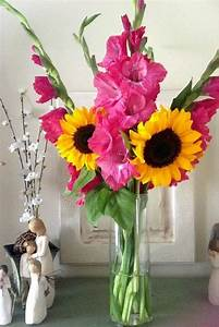 pink gladiolas and sunflower bouquet bridal bouquets