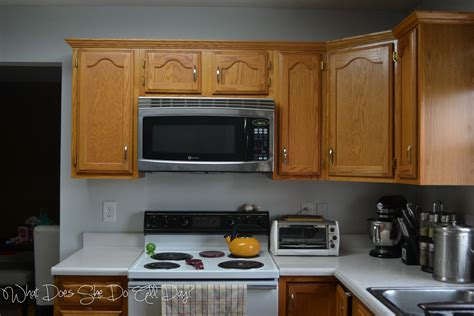 grey wall  white cabinets  warm brown chairs crisp