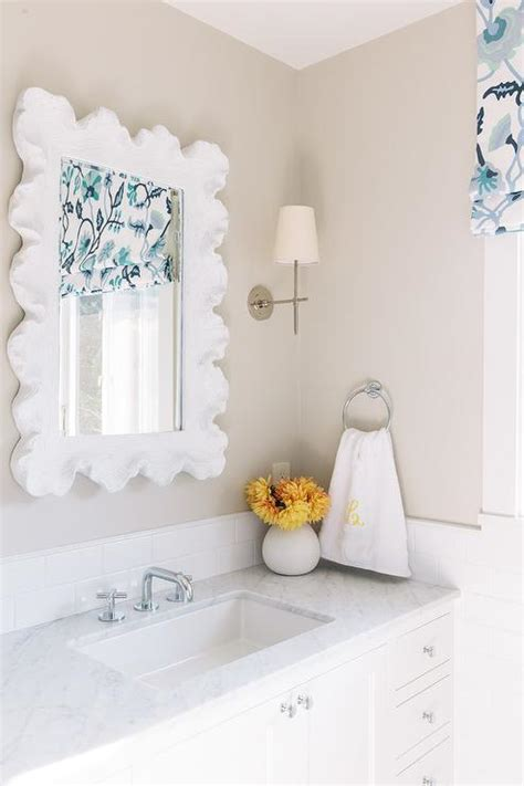 white scalloped bathroom sink mirror transitional bathroom