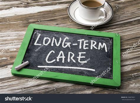 Long-term Care Handwritten On Blackboard Stock Photo