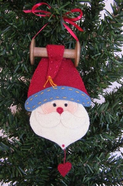 wool applique santa ornament   vintage wooden bobbin