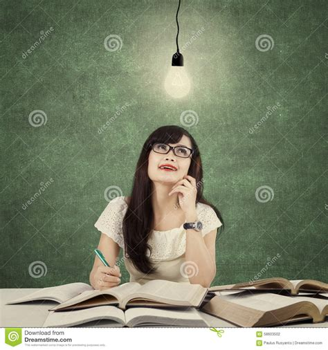 student studying and get idea light bulb stock photo