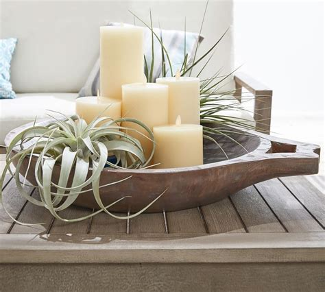 Every little design touch is purposefully created to elicit a sense of awe. Round Dough Bowl | Decorating coffee tables, Kitchen table centerpiece candles, Coffee table ...