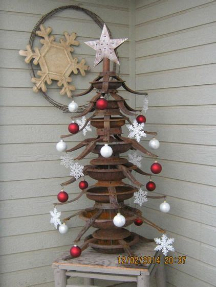 creative tree stands playsingarden has created a tree like no other by artfully stacking rusted tree stands