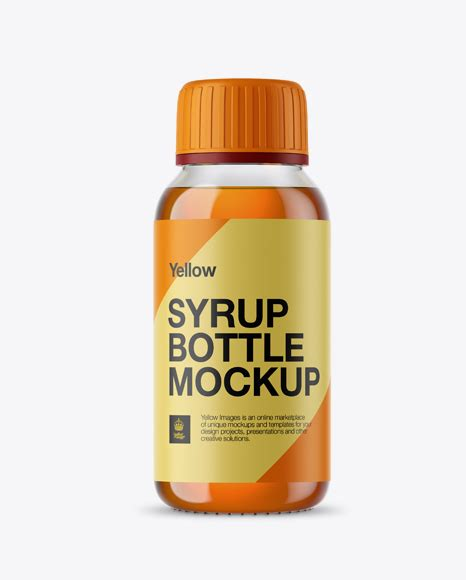 Mockup featuring a glass water bottle placed on a clear surface and surrounded by different items. 55+ Best Syrup Bottle Mockup Templates | Free & Premium