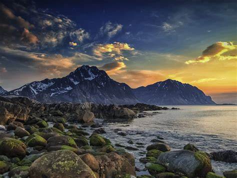 spring sea islands lofoten mountain boulders seashore sky