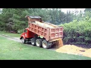 Spreading Sand with the dump truck - YouTube