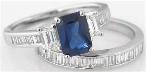 emerald cut sapphire  baguette diamond engagement ring