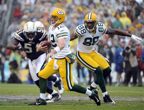 Aaron Rodgers And Takeo Spikes Photos Photos