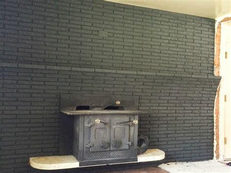 remodelaholic painted black brick fireplace