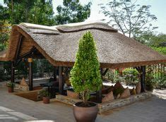 Thatched Roof House With Outdoor Entertaining Spaces by Classic Modern Pavilion Search Larimer