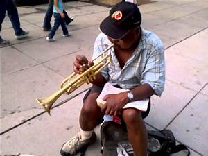 2013 Street corner trumpet player in Washington DC play ...