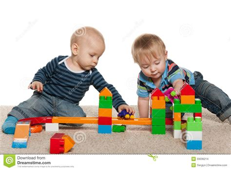 Two Baby Boys Are Playing Stock Images