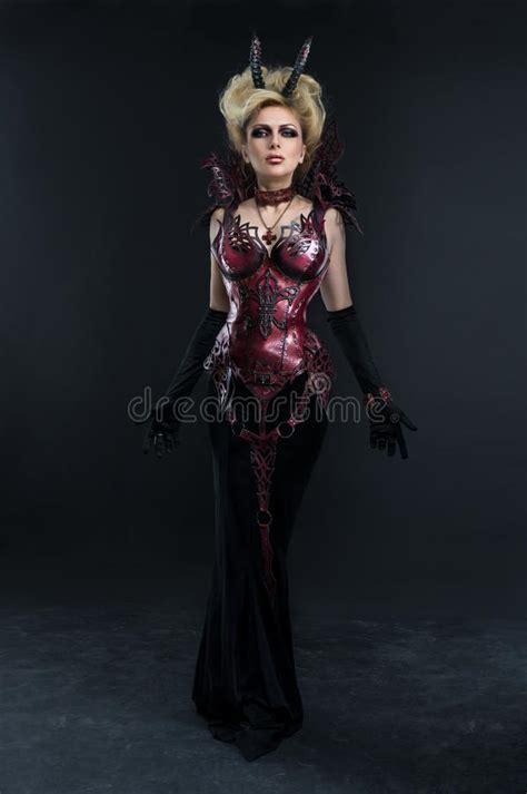 dangerous woman witch  fire ball stock photo image