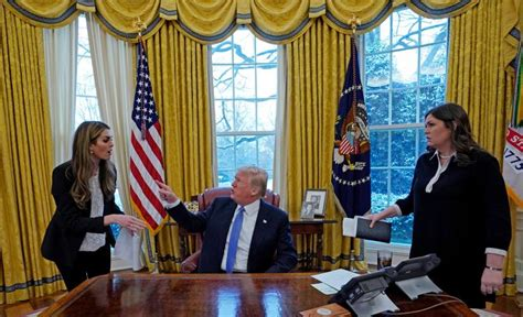 U.S. President Donald Trump speaks with Hope Hicks during ...