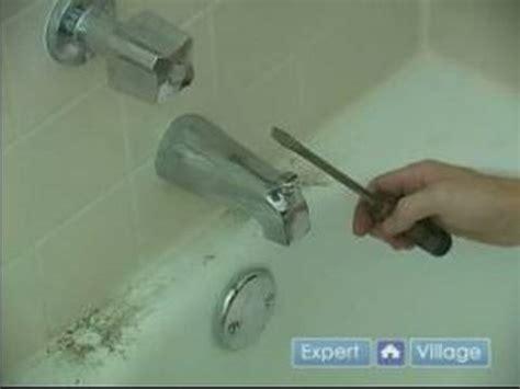 fix  leaky bathtub faucet removing  spout