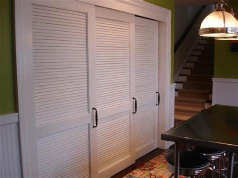 white sliding louvered doors  hallway cupboard