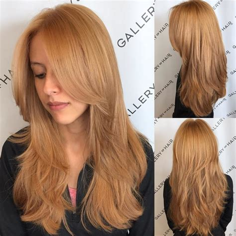 womens golden strawberry blonde shaggy layered cut