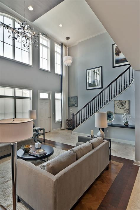 gorgeous high ceilings  large open floor plans create  cozy atmosphere   family