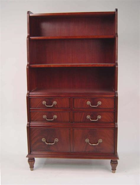 mahogany bookcase  chest  drawers