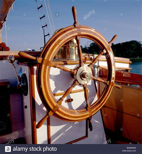 What Is The Helm Of A Boat by Detail Of The Wooden Steering Wheel Or Helm On An