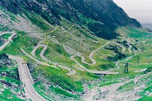 Aerial Photo of Green Scenery and Winding Road · Free Stock Photo
