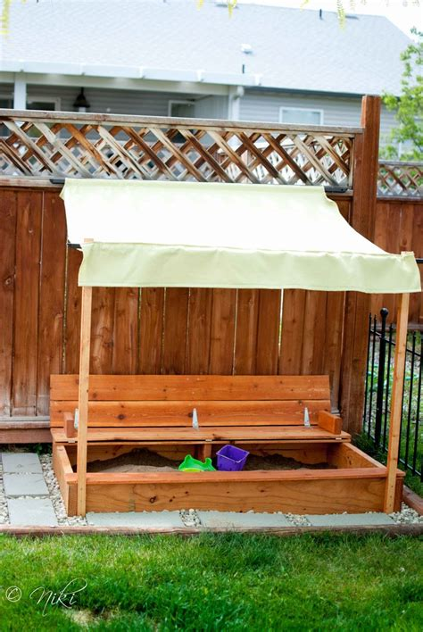 white modified sandbox with built in seat diy projects