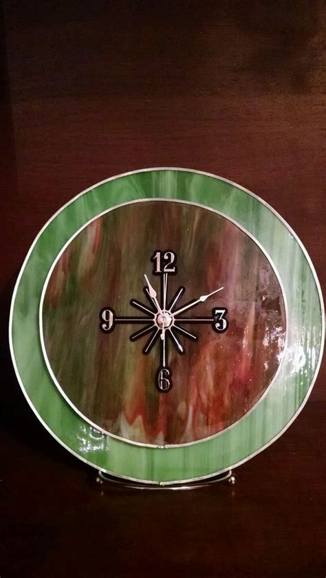 Find paintings from a vast selection of collectable clocks. This dual-layered stained glass clock is 2 pieces of ...