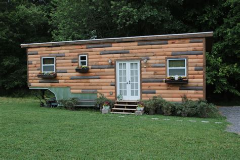 Woodpaneled Tiny House Built On A Gooseneck Trailer