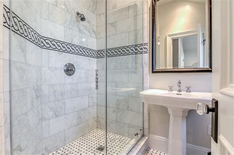 black  white chain accent border shower tiles