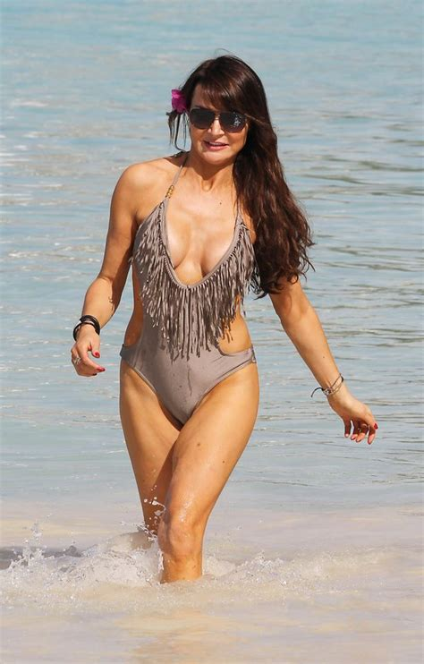 Lizzie Cundy shows off her perfect beach bod in daring panel swimsuit - Mirror Online