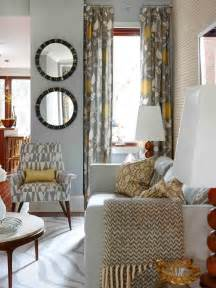 Hgtv Livingroom Gray And Gold Living Room This Mid Century Modern Sitting Area Features A A Mix Of Patterns In