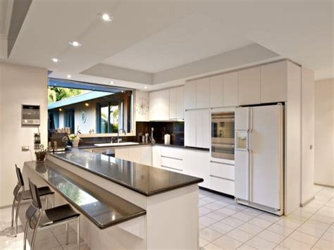Modern open plan kitchen design using granite Kitchen