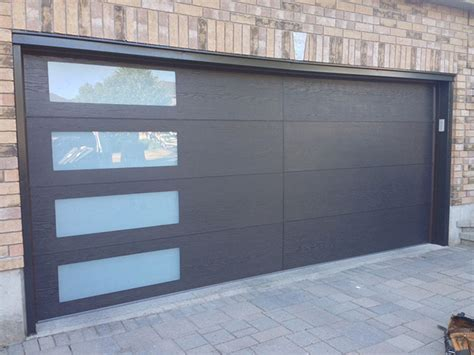 modern woodgrain garage door  door lites installed