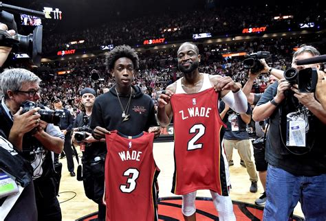 zaire wade shows   front  dwyane wade lebron james