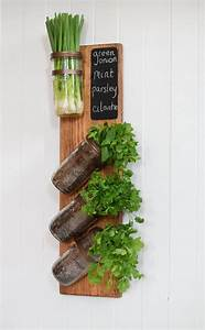 best 25 wall mounted planters ideas on pinterest indoor With kitchen cabinets lowes with outdoor metal flower wall art