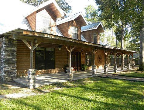 distinctive log cabin with wrap around porch bistrodre
