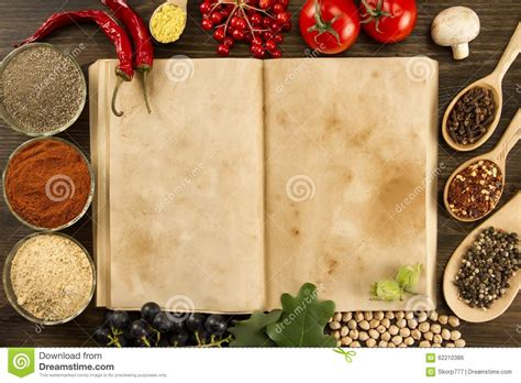 cuisines vintage open vintage book with spices on wooden background