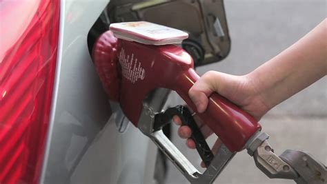 Filling Up Car Gas Tank With Fuel At Station. Closeup On