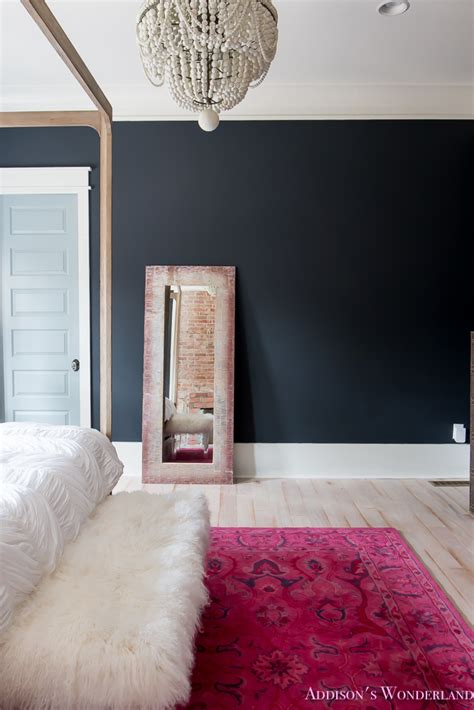 master bedroom black walls white wood bead chandelier